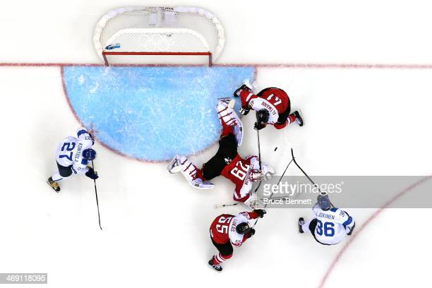 Bernhard Starkbaum of Austria tends goal against Finland during the Men's Ice Hockey Preliminary Round Group B game on day six of the Sochi 2014...