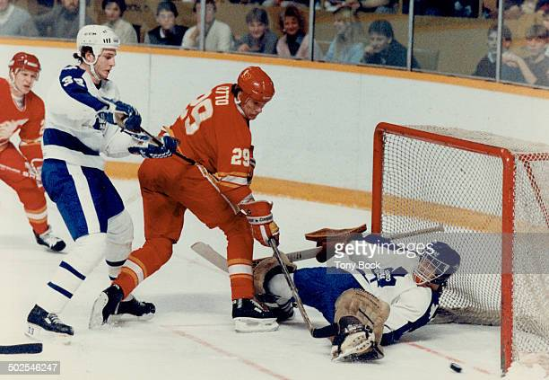 Bernhardt beaten Joel Otto outmuscles Leafs' Al lafrate at the edge of the crease to flip a shot past Leaf goalie Tim Bernhardt to put the Flames up...