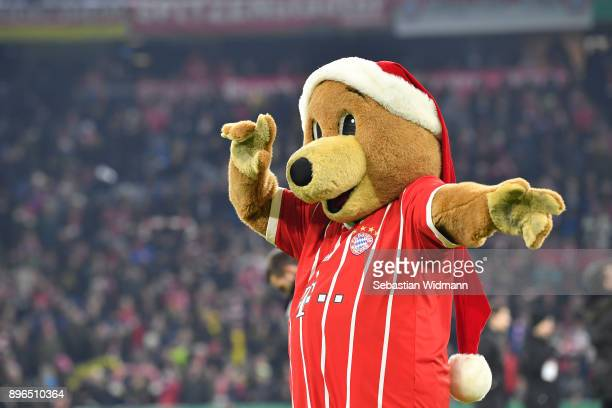 Berni mascot of FC Bayern Muenchen gestures during the DFB Cup match between Bayern Muenchen and Borussia Dortmund at Allianz Arena on December 20...
