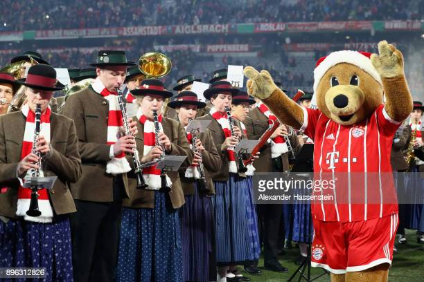 Berni mascot of FC Bayern Muenchen reacts during the DFB Cup match between Bayern Muenchen and Borussia Dortmund at Allianz Arena on December 20 2017...