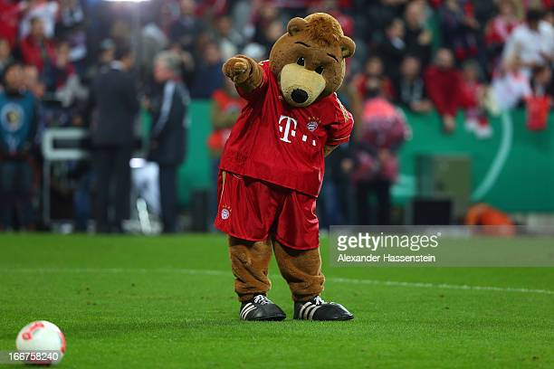 Berni mascot of Muenchen plays with the ball after the DFB Cup Semi Final match between Bayern Muenchen and VfL Wolfsburg at Allianz Arena on April...