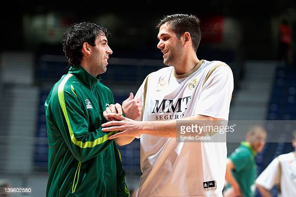 Berni Rodriguez, #5 of Unicaja and Felipe Reyes, #9 of Real Madrid warm up prior to the 2011-2012 Turkish Airlines Euroleague TOP 16 Game Day 5 match...