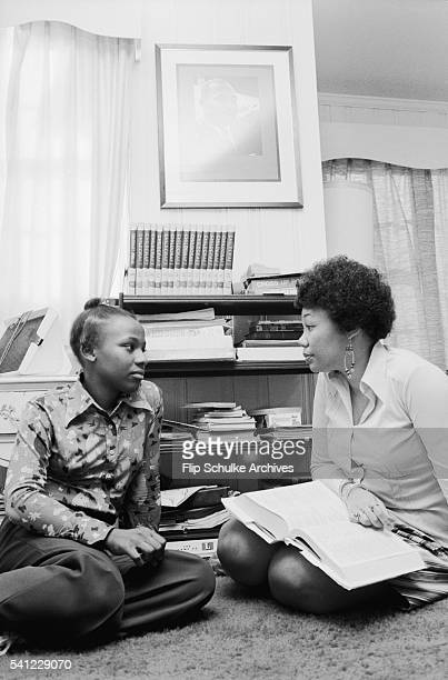 Bernice and Yolanda King daughters of Martin Luther King Jr chat with each other on their living room floor