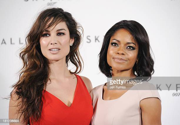 Bernice Marlohe and Naomie Harris attend a photo call with cast and filmmakers to mark the start of production on the 23rd Bond film 'Skyfall' at...