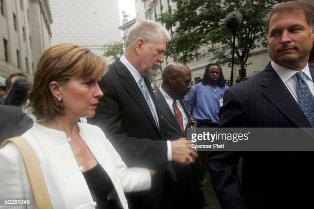 Bernie Ebbers the founder and former chief executive of WorldCom exits a Manhattan court with wife Kristie after being sentenced July 13 2005 in New...
