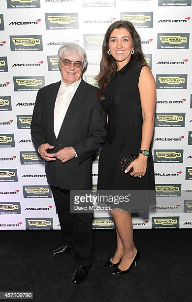 Bernie Ecclestone and Fabiana Flosi attend Technogym McLaren Celebrate 10 Years of Partnership at the McLaren Showroom on October 14 2014 in London...