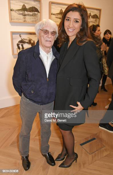 Bernie Ecclestone and Fabiana Flosi attend the private view of JR Giants Body of Work at Lazinc on January 10 2018 in London England
