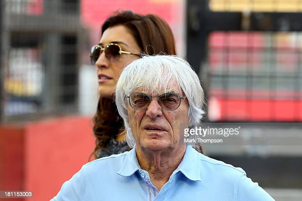 Bernie Ecclestone and his wife Fabiana Flosi are seen in the pit lane ahead of the Singapore Formula One Grand Prix at Marina Bay Street Circuit on...