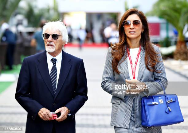 Bernie Ecclestone, Chairman Emeritus of the Formula One Group, and his wife Fabiana walk in the Paddock before the F1 Grand Prix of Russia at Sochi...