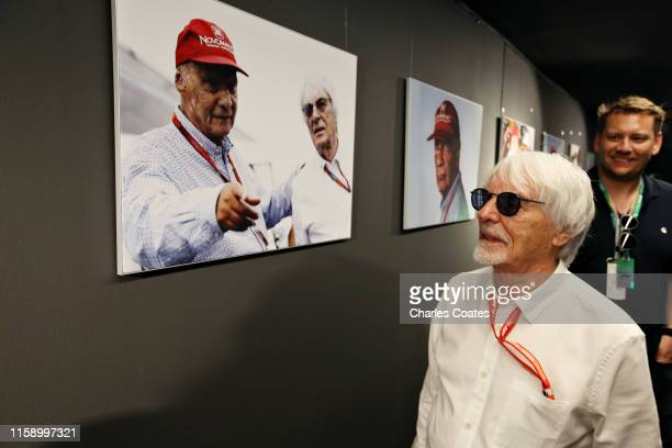 Bernie Ecclestone Chairman Emeritus of the Formula One Group looks at a circuit tribute to the late Niki Lauda in the Paddock before final practice...