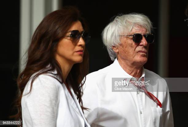Bernie Ecclestone, Chairman Emeritus of the Formula One Group, looks on in the Paddock with wife Fabiana before the Bahrain Formula One Grand Prix at...
