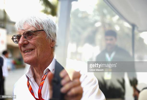 Bernie Ecclestone Chairman Emeritus of the Formula One Group rides on a circuit buggy in the Paddock during practice for the Bahrain Formula One...