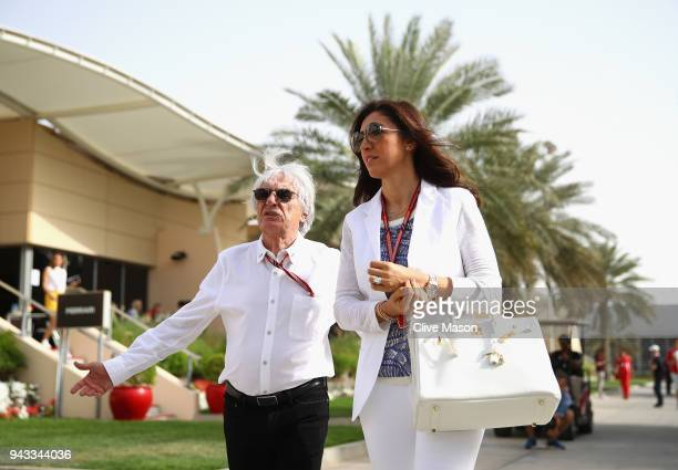 Bernie Ecclestone, Chairman Emeritus of the Formula One Group, talks in the Paddock with wife Fabiana before the Bahrain Formula One Grand Prix at...