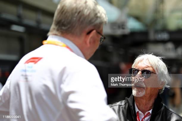 Bernie Ecclestone Chairman Emeritus of the Formula One Group talks with Ross Brawn Managing Director of the Formula One Group in the Paddock before...
