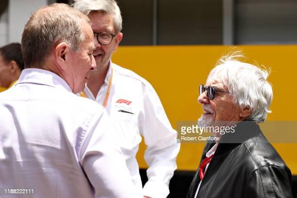 Bernie Ecclestone Chairman Emeritus of the Formula One Group talks with Ross Brawn Managing Director of the Formula One Group and Martin Brundle...