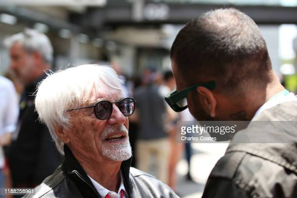 Bernie Ecclestone Chairman Emeritus of the Formula One Group talks with footballer Dani Alves in the Paddock before the F1 Grand Prix of Brazil at...