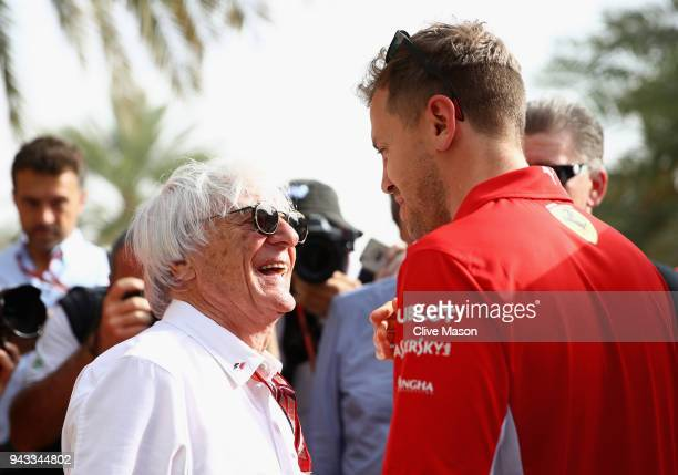 Bernie Ecclestone Chairman Emeritus of the Formula One Group talks with Sebastian Vettel of Germany and Ferrari in the Paddock before the Bahrain...
