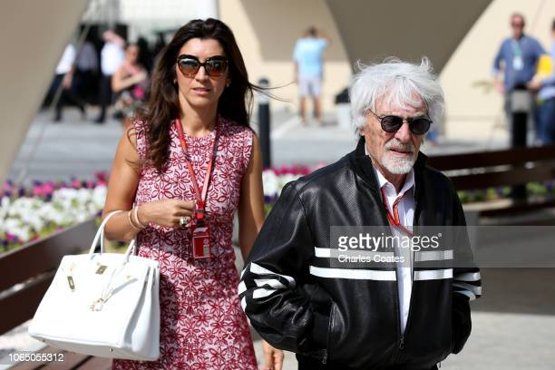 Bernie Ecclestone, Chairman Emeritus of the Formula One Group, walks in the Paddock with his wife Fabiana before the Abu Dhabi Formula One Grand Prix...
