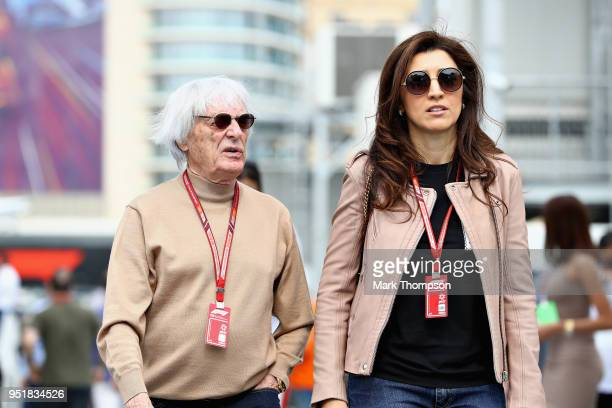 Bernie Ecclestone, Chairman Emeritus of the Formula One Group, walks with his wife Fabiana Ecclestone in the Paddock during practice for the...