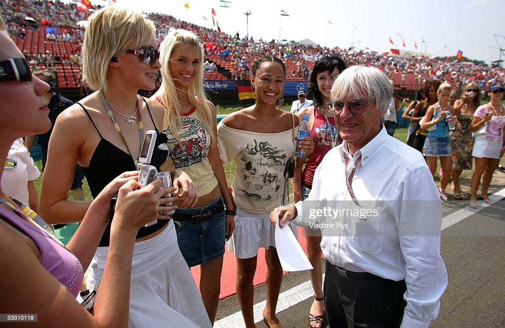 Bernie Ecclestone chats on the starting grid with the girls before the Hungarian F1 Grand Prix on July 31, 2005 in Budapest, Hungary.