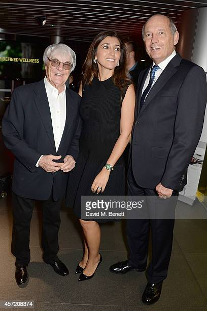 Bernie Ecclestone Fabiana Flosi and Ron Dennis attend Technogym McLaren Celebrate 10 Years of Partnership at the McLaren Showroom on October 14 2014...