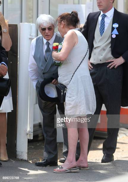 Bernie Ecclestone is seen getting given a lucky charm as he goes into Royal Ascot 2017 at Ascot Racecourse on June 21 2017 in Ascot England