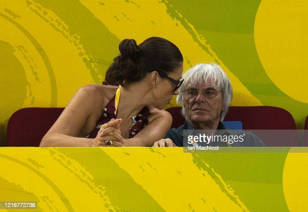 Bernie Ecclestone looks on as Chris Hoy of Great Britain competes in the Men's Sprint Semi Final against Mickael Bourgain of France in the track...