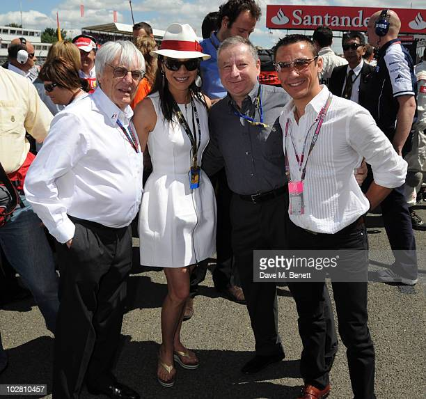 Bernie Ecclestone Michelle Yeo Jean Todt and Frankie Dettori visit the F1 grid during race day ahead of the Formula One British Grand Prix at...
