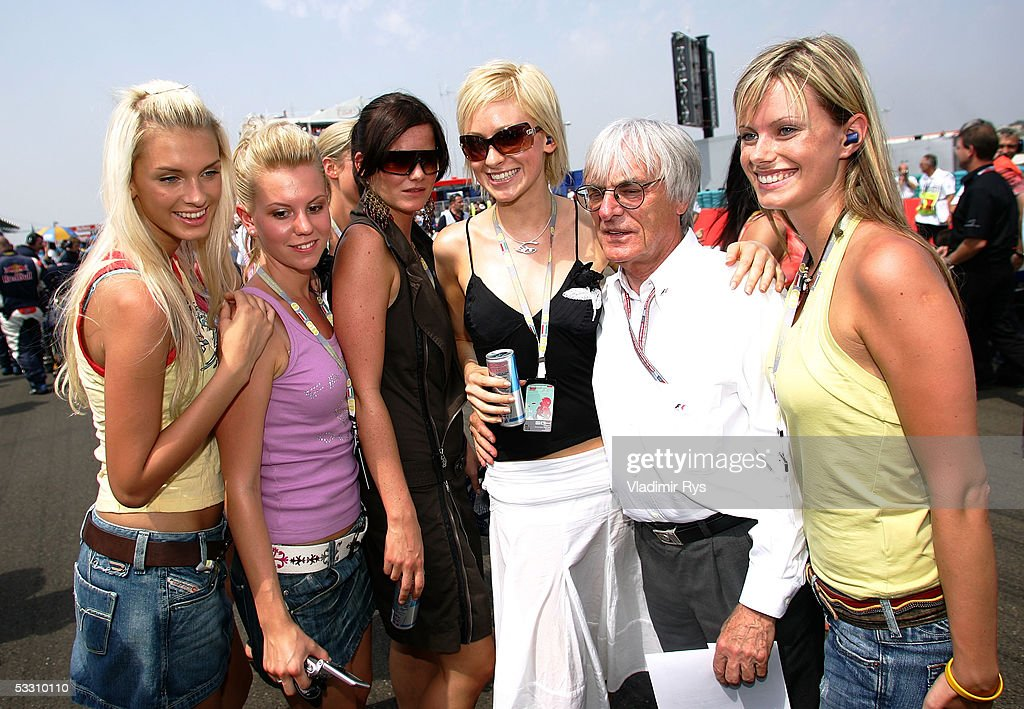 Bernie Ecclestone pose on the starting grid with the girls for the photographers before the Hungarian F1 Grand Prix on July 31, 2005 in Budapest, Hungary.