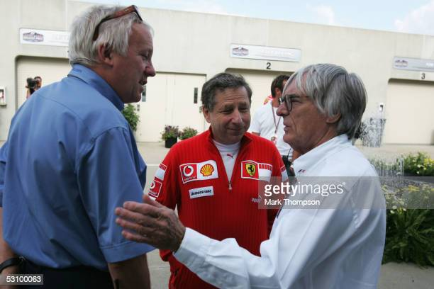 Bernie Ecclestone talks with race director Charlie Whiting and Ferrari chief Jean Todt after qualifying for the United States F1 Grand Prix at the...