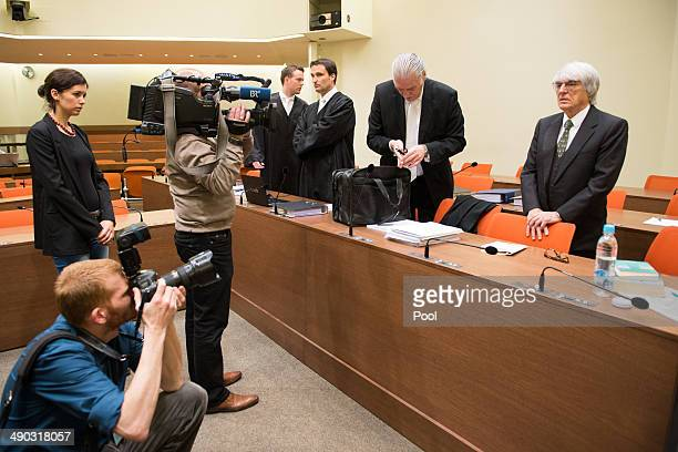 Bernie Ecclestone the 83yearold controlling business magnate of Formula One racing and his lawyers Norbert Scharf and Sven Thomas attend his trial...