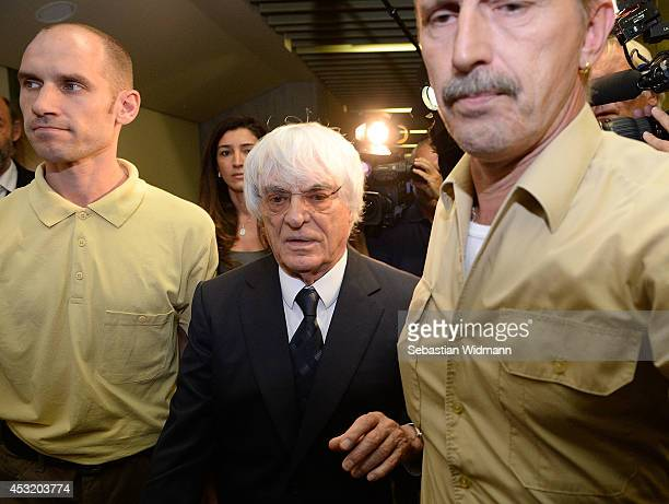 Bernie Ecclestone the head of Formula One racing and his wife Fabiana Flosi depart the Oberlandgericht Muenchen courthouse after judges agreed to...