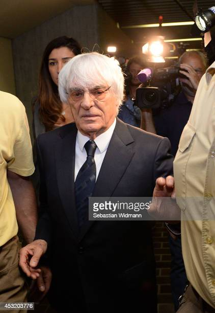 Bernie Ecclestone the head of Formula One racing and his wife Fabiana Flosi depart the Oberlandesgericht Muenchen courthouse after judges agreed to...