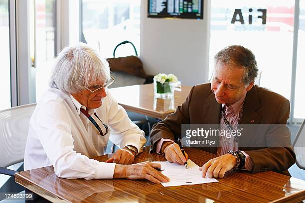 Bernie Ecclestone the President and CEO of the Formula One Group and Jean Todt the President of the FIA sign a memorandum agreement setting out the...