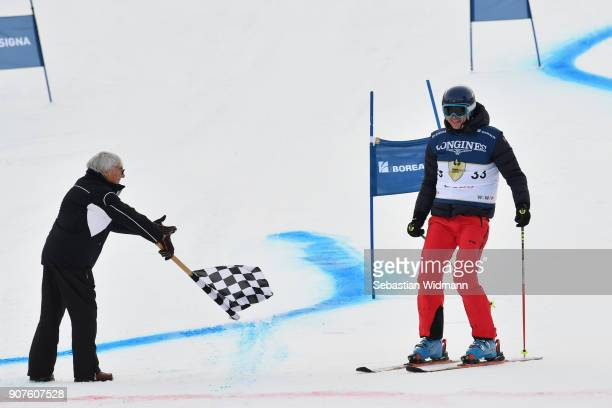 Bernie Ecclestone waves the checkered flag at Toto Wolff during the KitzCharityTrophy on January 20 2018 in Kitzbuehel Austria