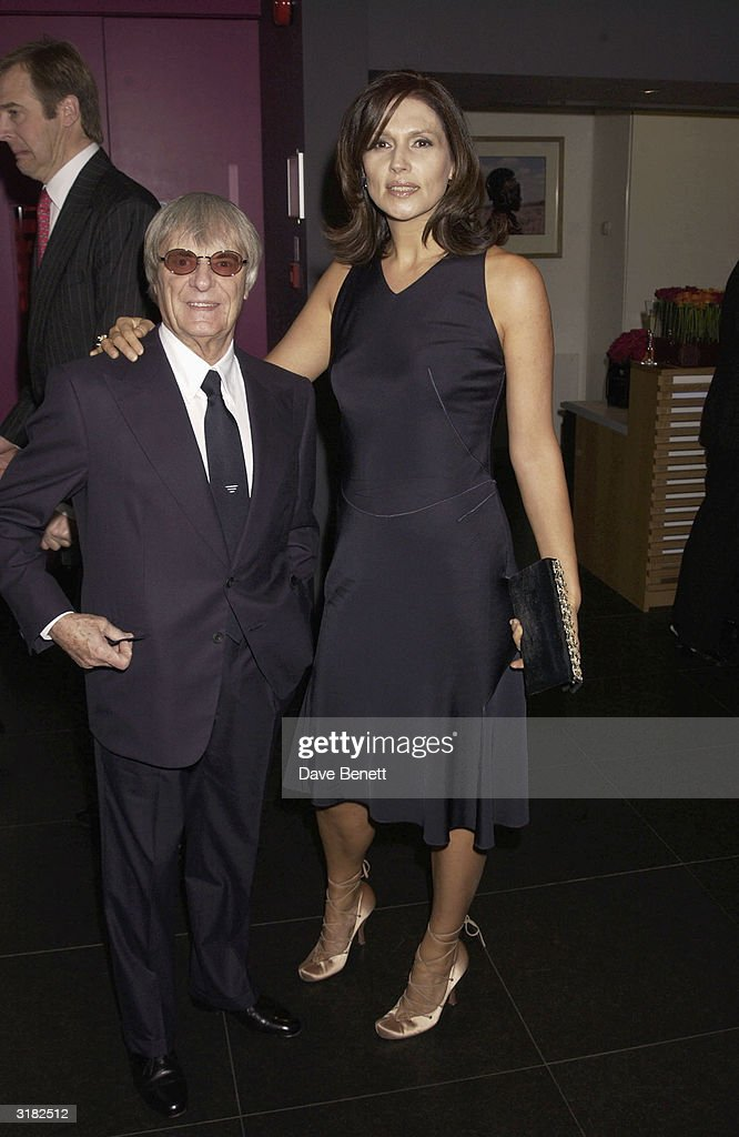 Bernie Ecclestone with his wife Slavica at a 'Tommy's Charity' party on 24th November 2002. The party was organised by McLaren Formula One team principle, Ron Dennis and his wife Lisa and held at the 'Bloomberg' building in the City Of London.