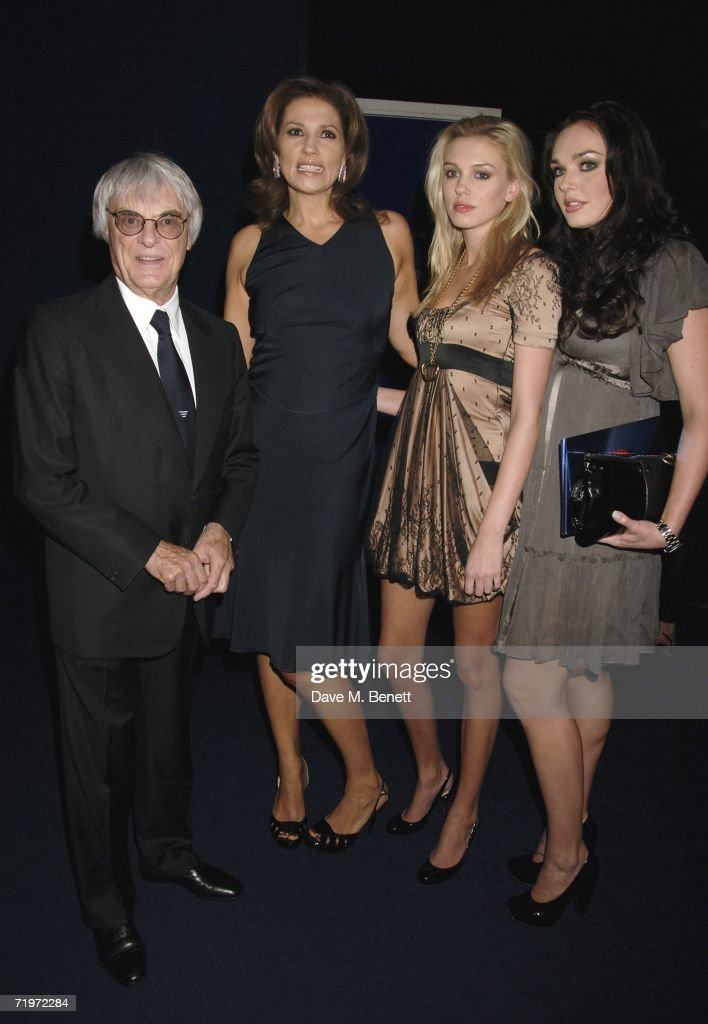 Bernie Ecclestone with wife Slavica Ecclestone and daughters Petra (C) and Tamara (R) attend the fashion show and party to celebrate the launch of Emporio Armani RED collection, at Earls Court on September 21, 2006 in London, England.