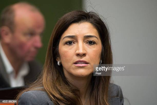 Bernie Ecclestones wife Fabiana Flosi speaks in court during the Bernie Ecclestone trial for charges of bribery on August 5 2014 in Munich Germany...