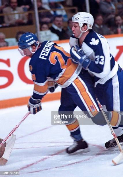 Bernie Federko of the St Louis Blues skates against Al Iafrate of the Toronto Maple Leafs during NHL game action on March 9 1989 at Maple Leaf...