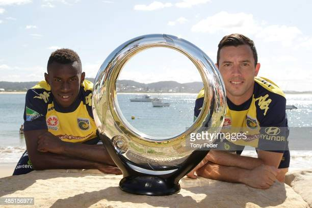 Bernie Ibini and John Hutchinson of the Central Coast Mariners poses with the ALeague Finals Series Trophy at The Haven on April 17 2014 in Terrigal...