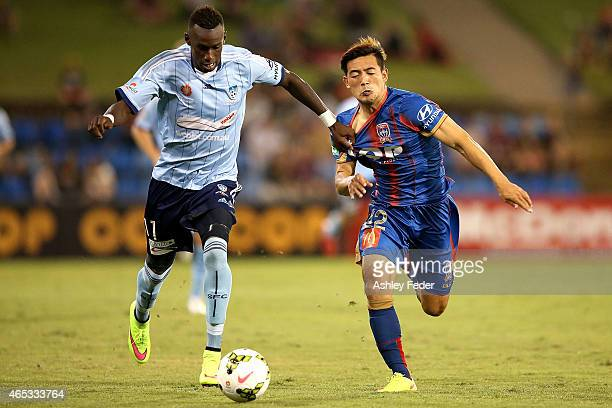 Bernie Ibini of Sydney FC contests the ball against Kije Lee of the Jets during the round 20 ALeague match between the Newcastle Jets and Sydney FC...