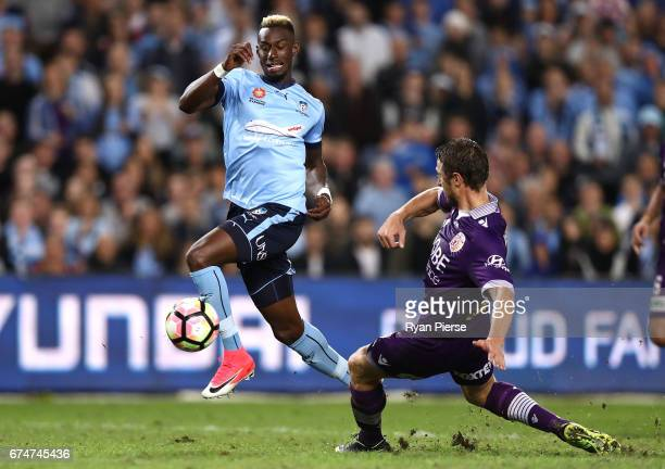 Bernie Ibini of Sydney FC is tacked by Dino Djulbic of the Glory during the ALeague Semi Final match between Sydney FC and the Perth Glory at Allianz...