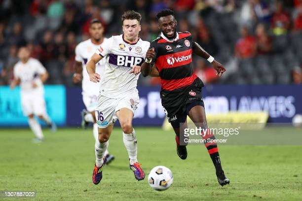 Bernie Ibini of the Wanderers and Nicholas Sullivan of the Glory contest the ball during the A-League match between the Western Sydney Wanderers and...