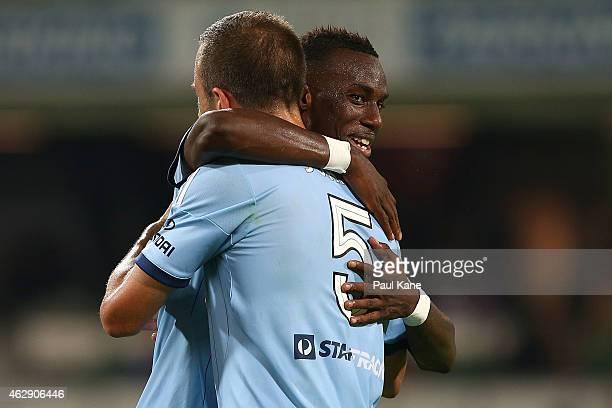 Bernie IbiniIsei of Sydney and Matt Jurman celebrate after winning the round 16 ALeague match between the Perth Glory and Sydney FC at nib Stadium on...