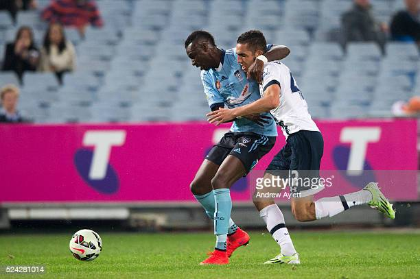 Bernie IbiniIsei of Sydney FC and Nabil Bentaleb of the Hotspur contest the ball during the friendly match between Sydney FC and the Tottenham...