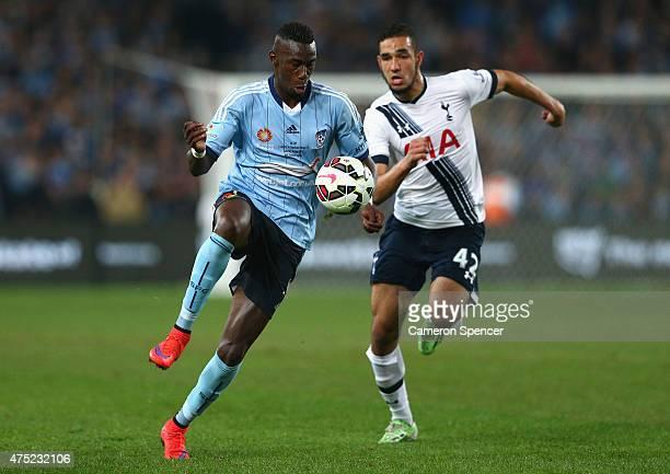 Bernie IbiniIsei of Sydney FC and Nabli Bentaleb of Hotspur contest the ball during the international friendly match between Sydney FC and Tottenham...