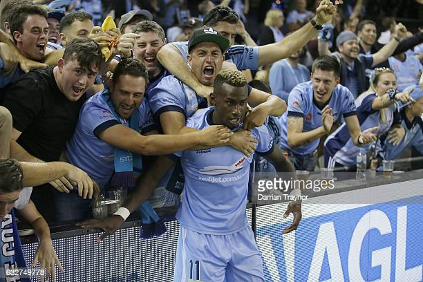 Bernie IbiniIsei of Sydney FC celebrates a goal with fans during the round 17 ALeague match between the Melbourne Victory and Sydney FC at Etihad...