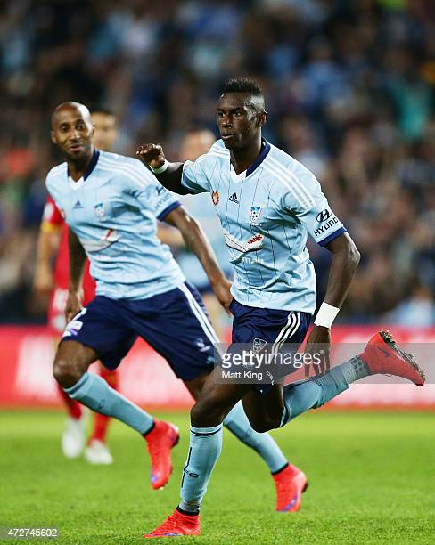 Bernie IbiniIsei of Sydney FC celebrates scoring the first goal follwed by Mickael Tavares during the ALeague Semi Final match between Sydney FC and...