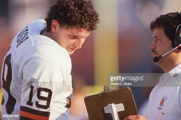 LOS ANGELES CA Bernie Kosar of the Cleveland Browns circa 1987 confers with a coacj in a game against the Los Angeles Raiders at the Coliseum in Los...