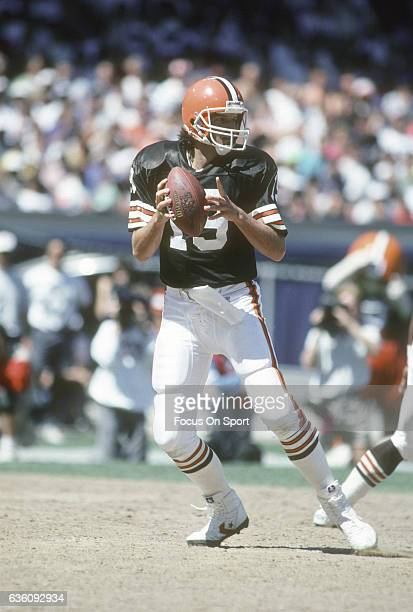 Bernie Kosar of the Cleveland Browns drops back to pass against the Dallas Cowboys during an NFL football game September 1 1991 at Municipal Stadium...